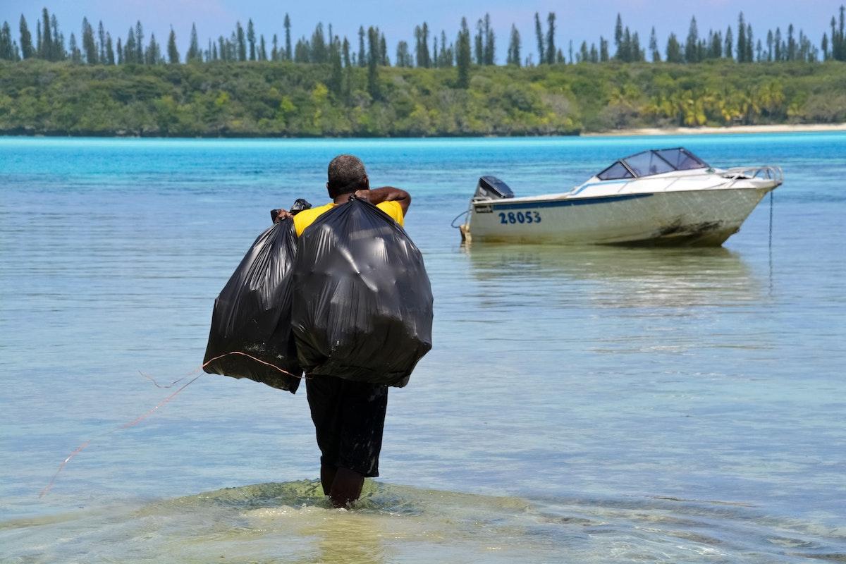 Ocean, boat, plastic waste